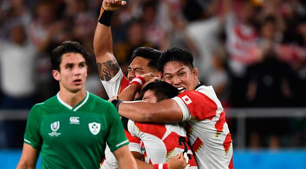 Japan's players celebrate their upset victory over Ireland.