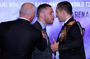 Manager Barry McGuigan separates Carl Frampton and Scott Quigg (right) during a press conference at the Europa Hotel, Belfast. PRESS ASSOCIATION Photo. Picture date: Wednesday November 18, 2015. See PA story BOXING Frampton. Photo credit should read: Niall Carson/PA Wire