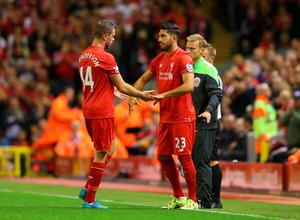 LIVERPOOL, ENGLAND - AUGUST 17:  Jordan Henderson of Liverpool shakes hands with team mate Emre Can as he is substituted during the Barclays Premier League match between Liverpool and A.F.C. Bournemouth at Anfield on August 17, 2015 in Liverpool, United Kingdom.  (Photo by Alex Livesey/Getty Images)