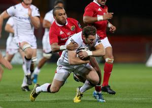 Gotcha: Darren Cave is tackled by Simon Zebo