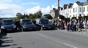 Children release balloons during  the funeral of John, Tomas and Amelia Mullan  at St Pius X Parish Church in Moville on Monday. Pic Colm Lenaghan/Pacemaker