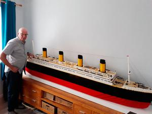 Keith Morton beside his 9ft model of the Titanic built out of 40,000 Lego bricks