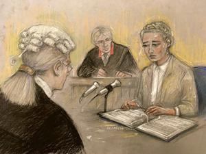 Court artist sketch by Elizabeth Cook of actress Amber Heard being cross examined by Eleanor Laws QC (Elizabeth Cook/PA)