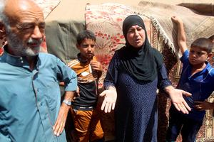 Iraqi families, who fled the city of Ramadi after it was seized by Islamic State (IS) group militants, talk to journalists at a camp housing displaced families on May 18, 2015 in Bzeibez, on the southwestern frontier of Baghdad with Anbar province. Shiite militias converged on Ramadi in a bid to recapture it from jihadists who dealt the Iraqi government a stinging blow by overrunning the city in a deadly three-day blitz. AFP PHOTO / AHMAD AL-RUBAYEAHMAD AL-RUBAYE/AFP/Getty Images