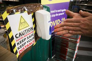General view of shoppers at the Wall Group Spar Shop in Ardoyne, north Belfast where staff and customers are practising stringent social distancing rules and hygiene practices in a bid to stop the spread of the Covid-19 virus. Photo by Kelvin Boyes  / Press Eye.