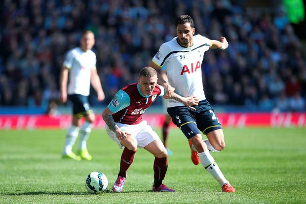 Tottenham Hotspur's Nacer Chadli (right) and Burnley's Kieran Trippier (left) battle for the ball during the Barclays Premier League match at Turf Moor, Burnley. Lynne Cameron/PA Wire.