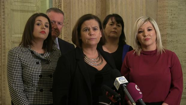 Sinn Fein president with party colleagues in Parliament Buildings, Belfast on Thursday November 21 (David Young/PA)