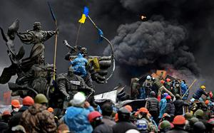 UKPEG PHOTO ESSAY PHOTOGRAPHER OF THE YEAR FINALIST  Anti-government protesters clash with police in Independence square despite a truce agreed between the Ukrainian president and opposition leaders on February 20, 2014 in Kiev, Ukraine. Picture: Jeff J Mitchell/Getty Images