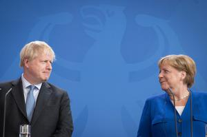 Prime Minister Boris Johnson and German Chancellor Angela Merkel spoke of the 'deep friendship' between the UK and Germany (Stefan Rousseau/PA)