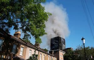 Smoke billows from a fire that has engulfed the 24-storey Grenfell Tower in west London.   Steve Paston/PA Wire