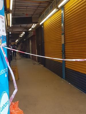 Police tape at the Reliance Arcade between Brixton Road and Electric Lane in south London, where a woman sought help from shopkeepers (Tess De La Mare/PA)