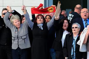 WARRINGTON, ENGLAND - APRIL 26:  Relatives of the Hillsborough sing 'You'll never walk alone' as they depart Birchwood Park after hearing the conclusions of the Hillsborough inquest on April 26, 2016 in Warrington, England. The fresh inquests into the 1989 Hillsborough disaster, in which 96 football supporters were crushed to death, concluded on April 26, 2016 with a verdict of unlawful killing, after the initial verdicts were quashed. Relatives of Liverpool supporters who died in Britain's worst sporting disaster gathered in the purpose-built court to hear the jury's verdict in Warrington after a 25 year fight to overturn the accidental death verdicts handed down at the initial 1991 inquiry.  (Photo by Christopher Furlong/Getty Images)