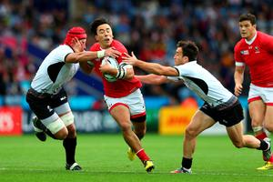 LEICESTER, ENGLAND - OCTOBER 06:  Nathan Hirayama of Canada goes between Mihai Macovei (L) and Michael Wiringi of Romania during the 2015 Rugby World Cup Pool D match between Canada and Romania at Leicester City Stadium on October 6, 2015 in Leicester, United Kingdom.  (Photo by Michael Steele/Getty Images)