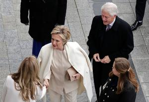 Former US President Bill Clinton and former Secretary of State Hillary Clinton arrive near the east front steps of the Capitol Building before President-elect Donald Trump is sworn in at the 58th Presidential Inauguration on Capitol Hill in Washington, D. on January 20, 2017. Donald Trump took the first ceremonial steps before being sworn in as the 45th president of the United States Friday -- ushering in a new political era that has been cheered and feared in equal measure. / AFP PHOTO / POOL / John ANGELILLOJOHN ANGELILLO/AFP/Getty Images