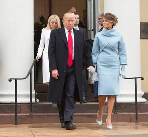 WASHINGTON, DC - JANUARY 20:  President-elect Donald J. Trump and first lady-elect Melania Trump depart St. John's Church on Inauguration Day on January 20, 2017 in Washington, DC. Donald J. Trump will become the 45th president of the United States today.  (Photo by Chris Kleponis - Pool/Getty Images)