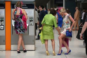 LONDON, ENGLAND - JUNE 20:  Racegoers travel by train from Waterloo station to Ascot racecourse to attend Royal Ascot on June 20, 2013 in London, England. The 'Royal Ascot' horse race meeting runs from June 18, 2013 until June 22, 2013 and has taken place since 1711. The racecourse is expected to welcome around 280,000 racegoers over the five days, including Her Majesty The Queen and other members of the Royal Family.  (Photo by Oli Scarff/Getty Images)