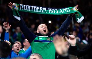 Northern Ireland fans in the stands during the 2018 FIFA World Cup Qualifying match at the HDI Arena, Hannover. PA