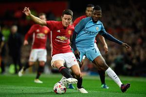 Manchester United's Spanish midfielder Ander Herrera (L) vies with Manchester City's Nigerian striker Kelechi Iheanacho during the EFL (English Football League) Cup fourth round match between Manchester United and Manchester City at Old Trafford in Manchester, north west England on October 26, 2016. AFP/Getty Images