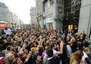 Fans took photos as Kate Moss launched her collection for Topshop at its Oxford Street store (Dominic Lipinski/PA Archive)