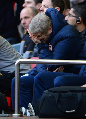 LIVERPOOL, ENGLAND - FEBRUARY 08:  Arsenal Manager Arsene Wenger looks dejected during the Barclays Premier League match between Liverpool and Arsenal at Anfield on February 8, 2014 in Liverpool, England.  (Photo by Michael Regan/Getty Images)