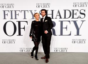 "LONDON, ENGLAND - FEBRUARY 12:  Director Sam Taylor-Johnson (L) and Aaron Taylor-Johnson attend the UK Premiere of ""Fifty Shades Of Grey"" at Odeon Leicester Square on February 12, 2015 in London, England.  (Photo by Ian Gavan/Getty Images)"