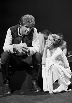 """FILE - In this Nov. 13, 1978 file photo, Harrison Ford talks with Carrie Fisher during a break in the filming of the CBS-TV special """"The Star Wars Holiday"""" in Los Angeles. On Tuesday, Dec. 27, 2016, a publicist says Fisher has died at the age of 60. (AP Photo/George Brich, File)"""