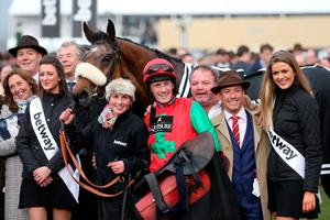 Jockey Sam Twiston-Davies celebrates with breeder Frankie Dettori (second right) after Dodging Bullets wins the Betway Queen Mother Champion Chase on Ladies Day during the Cheltenham Festival at Cheltenham Racecourse. PRESS ASSOCIATION Photo. Picture date: Wednesday March 11, 2015. See PA story RACING Cheltenham. Picture credit should read: David Davies/PA Wire. RESTRICTIONS: Editorial Use only, commercial use is subject to prior permission from The Jockey Club/Cheltenham Racecourse. Call +44 (0)1158 447447 for further information.