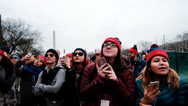 WASHINGTON, DC - JANUARY 20:  People watch from the National Mall the inauguration of Donald Trump on January 20, 2017 in Washington, DC. Washington and the entire nation are preparing for the transfer of the United States presidency later today as Donald Trump is sworn is as the 45th president Friday.  (Photo by Spencer Platt/Getty Images)