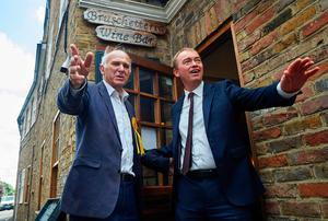 Leader of the Liberal Democrats, Tim Farron (R) and attends a campaign visit with the party's candidate for the Twickenham constituency, Vince Cable, in Twickenham, south-west London on June 7, 2017, on the eve of the general election. Britain on Wednesday headed into the final day of campaigning for a general election darkened and dominated by jihadist attacks in two cities, leaving forecasters struggling to predict an outcome on polling day. / AFP PHOTO / NIKLAS HALLE'NNIKLAS HALLE'N/AFP/Getty Images