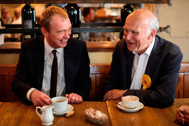TWICKENHAM, ENGLAND - JUNE 07: Liberal Democrat Leader Tim Farron (L) and former Secretary of State for Business, Innovation and Skills Vince Cable (R) sit in a restaurant as they campaign in Twickenham on June 7, 2017 in Twickenham, England. Mr Cable is campaigning to retake his former seat after it was won by Conservative Tania Mathias in the 2015 general election. Britain goes to the polls tomorrow June 8 in a general election. (Photo by Jack Taylor/Getty Images)