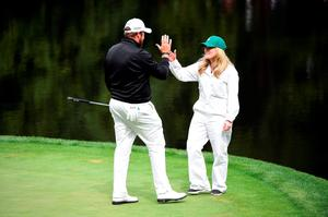 AUGUSTA, GEORGIA - APRIL 06:  Shane Lowry of Ireland and fiancee Wendy Honner react during the Par 3 Contest prior to the start of the 2016 Masters Tournament at Augusta National Golf Club on April 6, 2016 in Augusta, Georgia.  (Photo by Harry How/Getty Images)