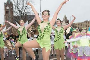 Dancers make their way past the Guildhall during Derry City and Strabane District Council's the annual Spring Carnival on St. Patrick's Day in Derry-Londonderry. Picture Martin McKeown. Inpresspics.com. 17.03.17