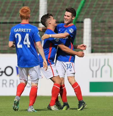 Linfield's Paul Smyth (right) celebrates his goal with Jordan Stewart and Robbie Garrett.