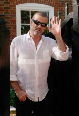 George Michael outside his house in Highgate, north London, after being released from prison, as the pop superstar has died peacefully at home, his publicist said.  11/10/10