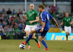 Republic of Ireland's Conor Sammon (left) and Faroe Islands' Rogvi Baldvinsson in action during the FIFA World Cup Qualifying match at the Aviva Stadium, Ireland. PRESS ASSOCIATION Photo. Picture date: Friday June 7, 2013. See PA story SOCCER Republic. Photo credit should read: Niall Carson/PA Wire