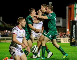 Damage done: Ulster's Johnny McPhillips can only look on as Connacht's Caolin Blade celebrates scoring a try with Kyle Godwin and Jack Carty last night