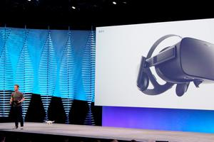 Facebook chief Mark Zuckerberg uses a small drone and an Oculus Rift virtual reality headset during a keynote presentation at the social network's annual developers gathering  in San Francisco on April 12, 2016. AFP/Getty Images