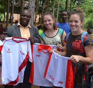 Beth and Serena donating kit from Ulster hockey in Uganda