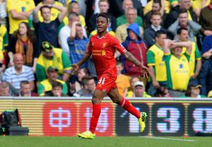 NORWICH, ENGLAND - APRIL 20:  Raheem Sterling of Liverpool celebrates scoring their third goal during the Barclays Premier League match between Norwich City and Liverpool at Carrow Road on April 20, 2014 in Norwich, England.  (Photo by Michael Regan/Getty Images)