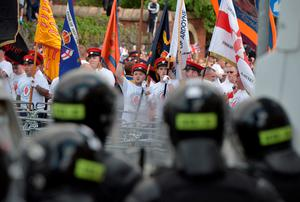 BELFAST, NORTHERN IRELAND - JULY 13:  Loyalists break through a police barrier as they are prevented from progressing on the return journey towards the controversial Ardoyne flashpoint the Twelfth of July parade on July 13, 2015 in Belfast, Northern Ireland. The Twelfth is an Ulster Protestant celebration held annually. It celebrates the victory of Protestant king William of Orange over Catholic king James II at the Battle of the Boyne in 1690, which helped ensure Protestant supremacy in Ireland at that time. This year the Twelfth takes place on the thirteenth of July due to the original date falling on a Sunday. (Photo by Charles McQuillan/Getty Images)