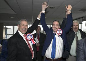Lisburn Leisure Plex - Election Count  - 3rd march 2017 Photograph by Declan Roughan Paul Givan elected, arm raised by Uel Mackin.
