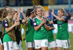 Northern Ireland's players receive the applause after securing a 1-1 draw with Scotland at Mourneview Park.