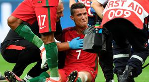 Down and out: But Ronaldo's tears of frustration turned to tears of joy when the Portugal superstar picked up the biggest prize in his glittering career