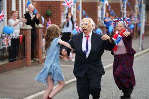 Residents from Leopold Street in the Woodvale area of North Belfast take part in street commemorations to mark the 75th anniversary of VE Day. Angela Brown and Jacqueline Kell dress up as Winston Churchill and Vera Lynn. Photo by Kelvin Boyes / Press Eye.