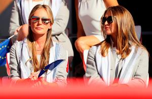 CHASKA, MN - SEPTEMBER 29: Erica Stoll and Eva Bossaerts look on during the 2016 Ryder Cup Opening Ceremony at Hazeltine National Golf Club on September 29, 2016 in Chaska, Minnesota.  (Photo by Andrew Redington/Getty Images)