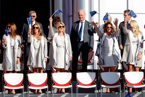 CHASKA, MN - SEPTEMBER 29: Eva Bossaerts, Kate Rose, Emma Stenson, Helen Storey and Nicole Willett wave flags during the 2016 Ryder Cup Opening Ceremony at Hazeltine National Golf Club on September 29, 2016 in Chaska, Minnesota.  (Photo by Jamie Squire/Getty Images)