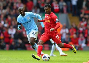 LIVERPOOL, ENGLAND - APRIL 13:  Yaya Toure of Manchester City competes with Daniel Sturridge of Liverpool during the Barclays Premier League match between Liverpool and Manchester City at Anfield on April 13, 2014 in Liverpool, England.  (Photo by Alex Livesey/Getty Images)