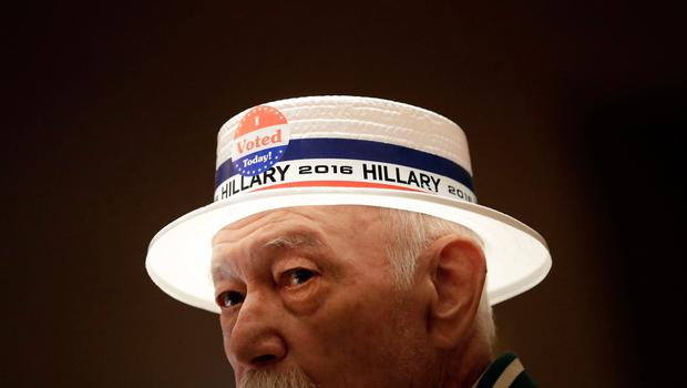 Julio Jacot wears a hat in support of Democratic presidential candidate Hillary Clinton at an election night watch party Tuesday, Nov. 8, 2016, in St. Louis. (AP Photo/Jeff Roberson)