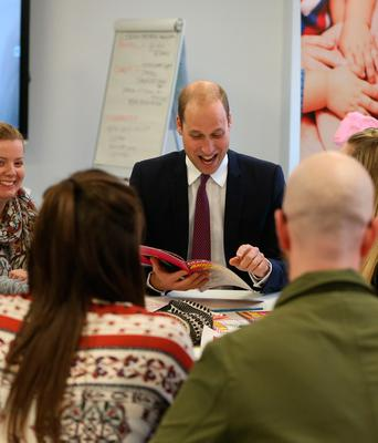 The Duke of Cambridge looks at the annual report during a visit  to Inspire, a charity and social enterprise which focuses on promoting wellbeing for all across the island of Ireland, as part of his tour of Belfast. PRESS ASSOCIATION Photo. Picture date: Wednesday October 4, 2017. Niall Carson/PA Wire
