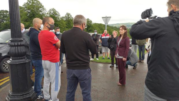Nichola Mallon speaking to protestors.
